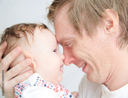 father with newborn daughter