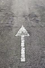 Arrow direction on asphalt