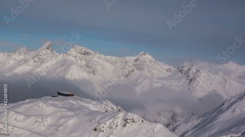 Mountain tops with low clouds in Ischgl resort Tirol Alps