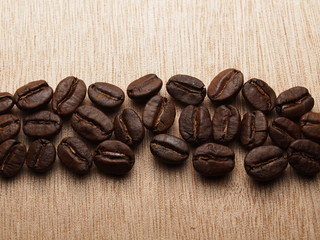 Roasted Coffee Beans on wood texture table