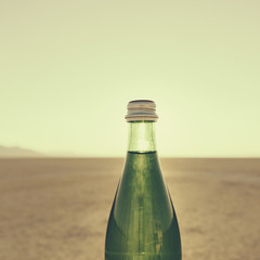 The Landscape Of The Black Rock Desert In Nevada. A Bottle Of Water. Filtered Mineral Water.