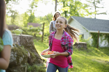 Organic Farm. Summer Party. Three Girls Running Across The Grass.