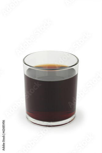 Glass of cola on white