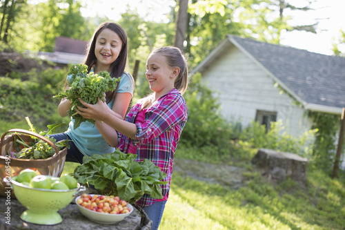 Organic Farm. Summer Party. Two Young Girls Preparing Salads.