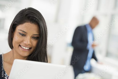 Business People. A Woman Using A Digital Tablet.