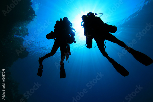 Foto op Canvas Duiken Two Scuba Divers silhouette