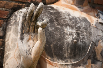 Hand of Buddha in temple of Sukhothai ancient city, The world he