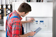 Leinwandbild Motiv Technician servicing heating boiler