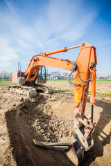 Power showel excavating in a construction site