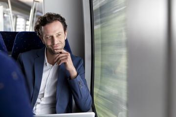 Geschäftsmann in einem Zug