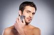 Man shaving.