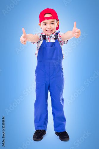 Little handyman showing double thumbs up