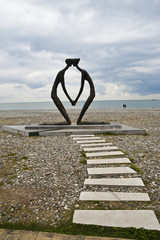 sculpture on a sea shore