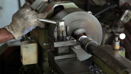Man working on a lathe