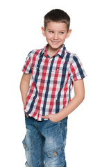 Smiling young boy on the white