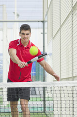 Paddle tennis player redy for shot