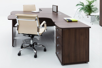 desks and leather chairs