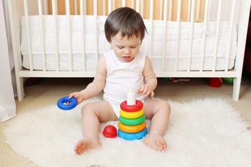 18 months baby plays nesting blocks