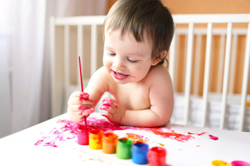 18 months baby with paints