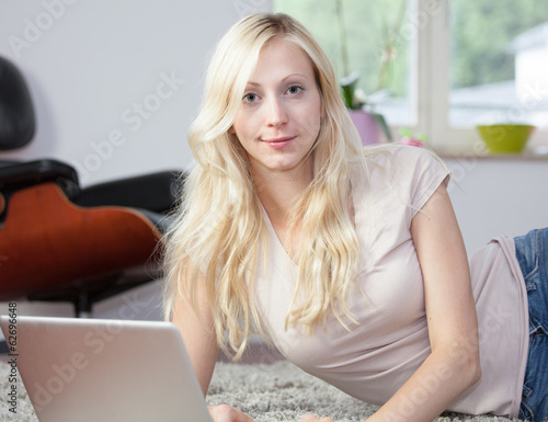 Relaxed woman is using laptop