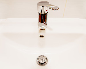White sink and chrome faucet with handle