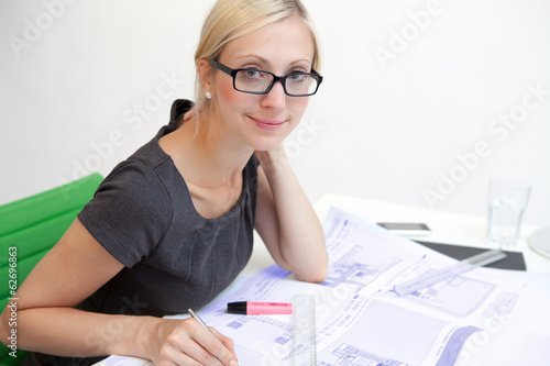 Business woman with blueprint