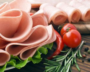 Fresh ham slices with lattuce and cherry tomato