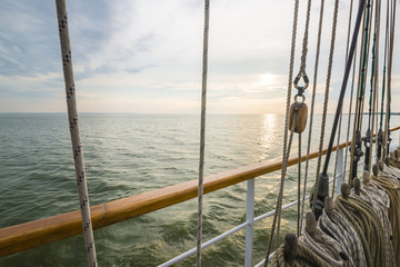 Wooden pulley in an old yacht, sunset