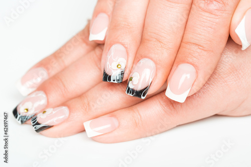 Female hands with manicure on a light background