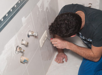 electrician repairing a socket
