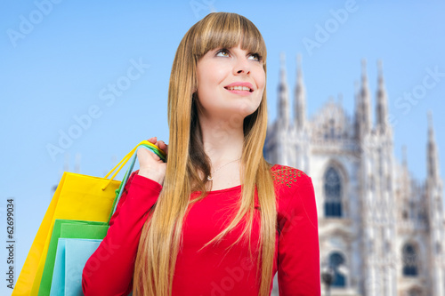 Woman holding shopping bags in Milan