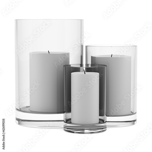 three glass candlesticks with candles isolated on white backgrou