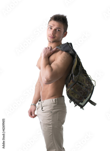 Muscular shirtless young man with military vest on shoulder