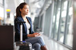 Leinwandbild Motiv Passenger traveler woman in airport