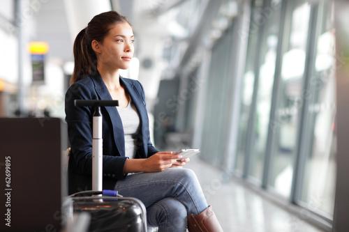 Leinwanddruck Bild Passenger traveler woman in airport
