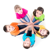Group of children sitting on the floor in a circle.