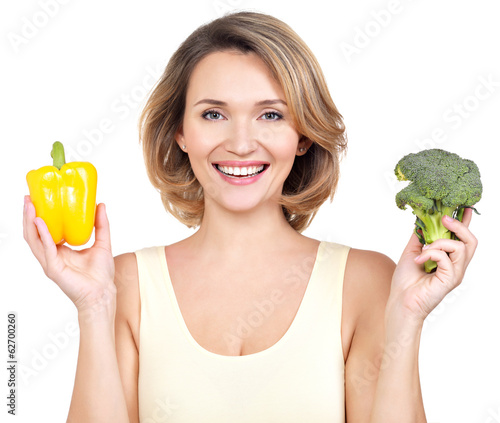 Portrait of a smiling young woman with vegetables.