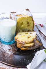 cake with raisins and a glass of milk