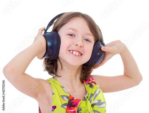 Music little girl in headphones