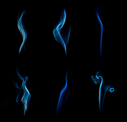Abstract blue smoke isolated on black background.