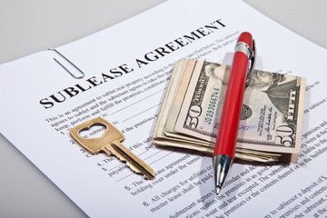 Sublease agreement with dollar notes golden key and pen