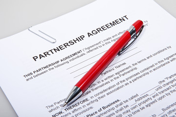 Partnership agreement forms with pen