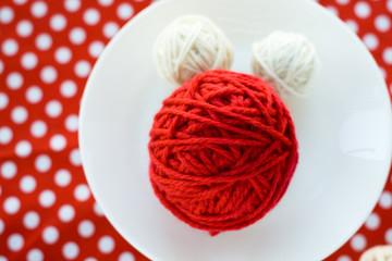 Bright balls of yarn on a background