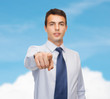friendly young buisnessman pointing finger