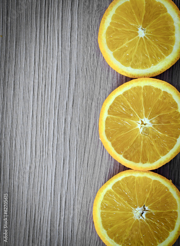 Oranges over Old Woody Background