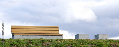 Modern bench on a grassy knoll 1