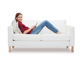 teenage girl sitting on sofa with tablet pc