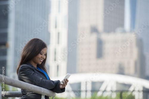 Summer. A Woman In A Grey Suit Using A Smart Phone.