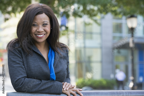 Summer. A Woman In A Grey Suit With A Bright Blue Shirt.
