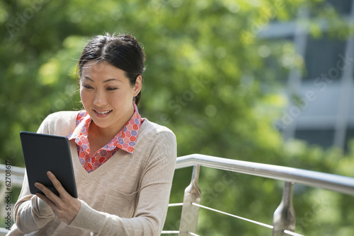 Summer. Business People. A Woman Using A Digital Tablet, Working. Keeping In Touch.